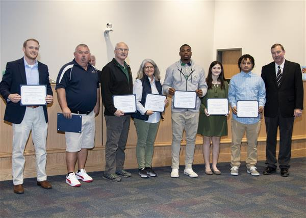 Conference players and coaches of the year from OCS are recognized at the January BOE meeting