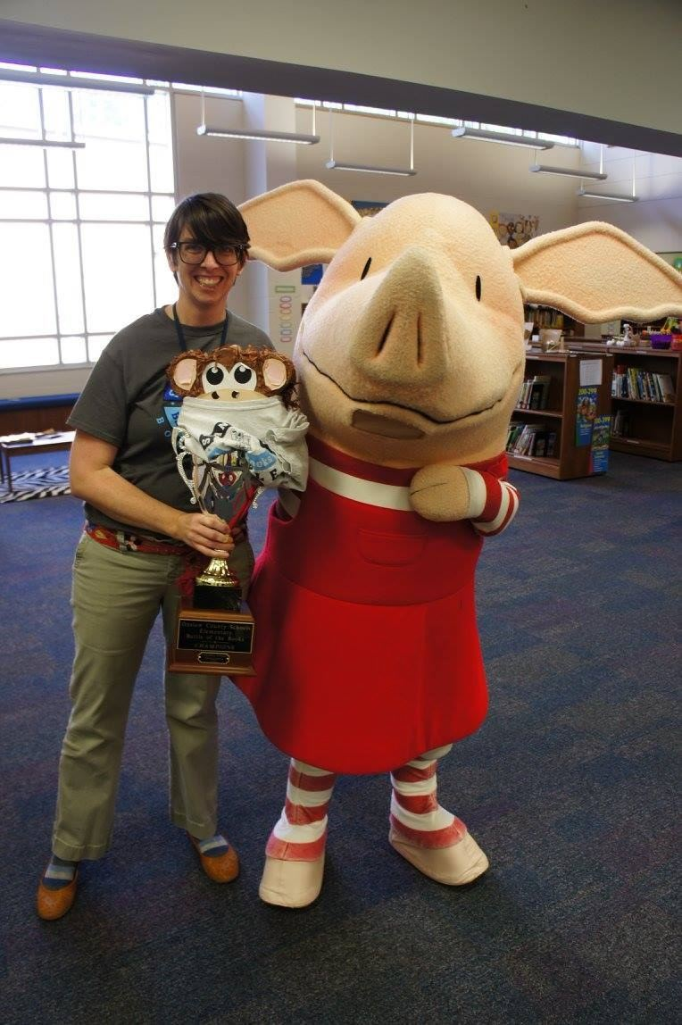 Mrs. Lynch with Olivia, the Pig