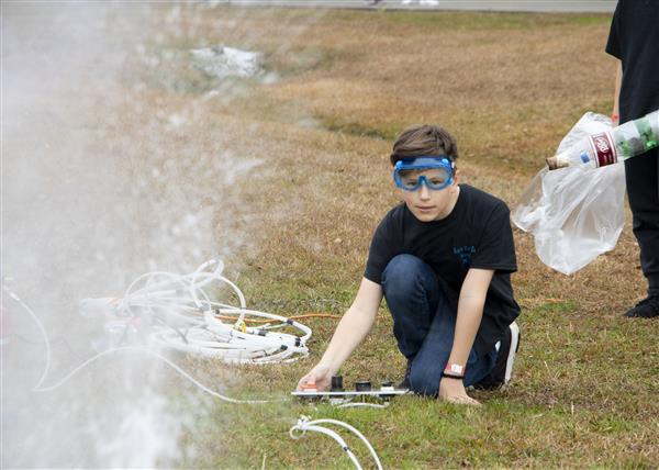 A student tests his rocket in 3,2,1 Blast Off