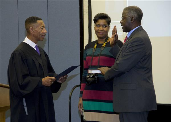 Bill Lanier is administered the oath of office by Chief District Court Judge Paul Hardison