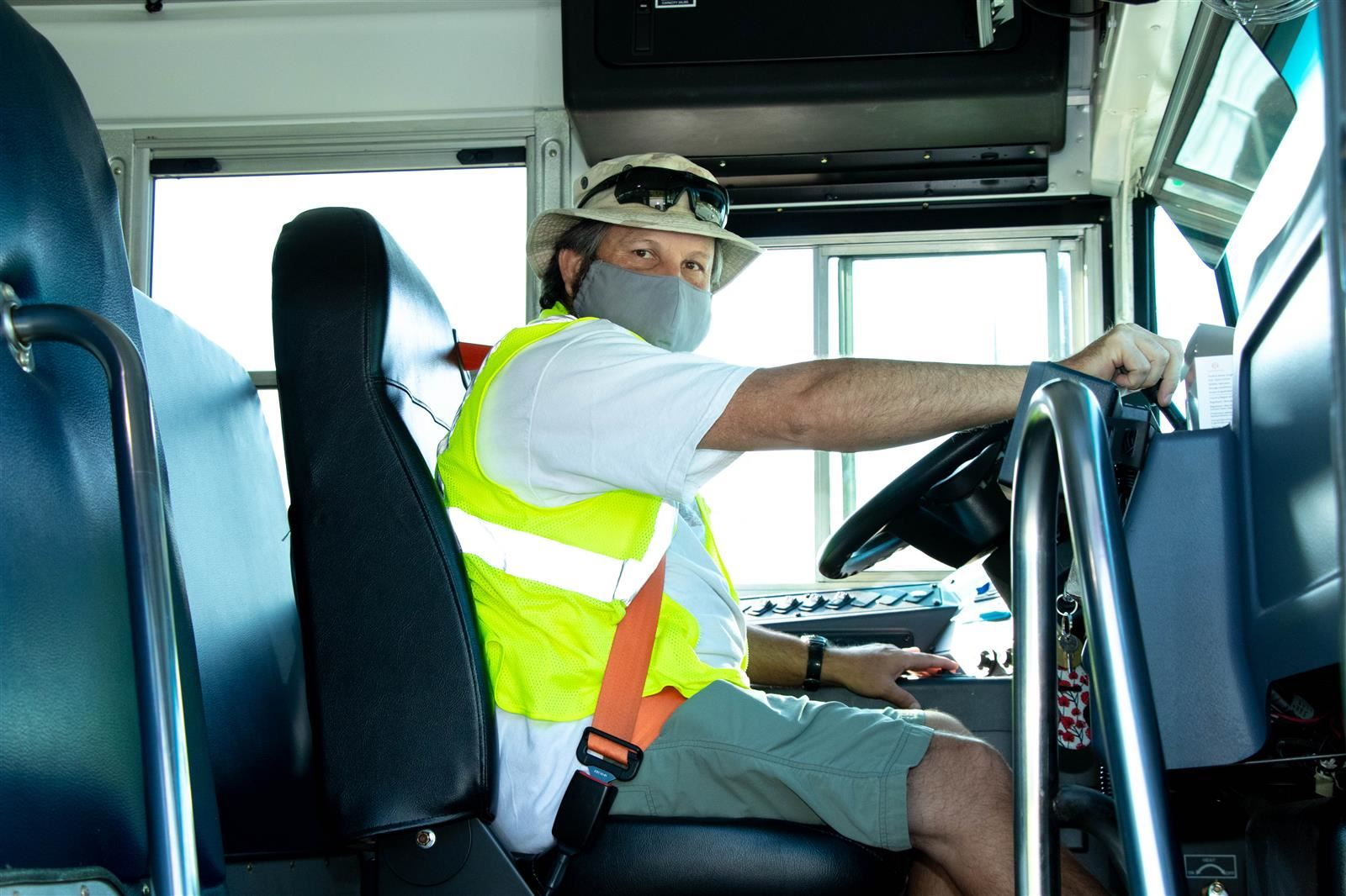 An OCS Bus Driver wears a face covering