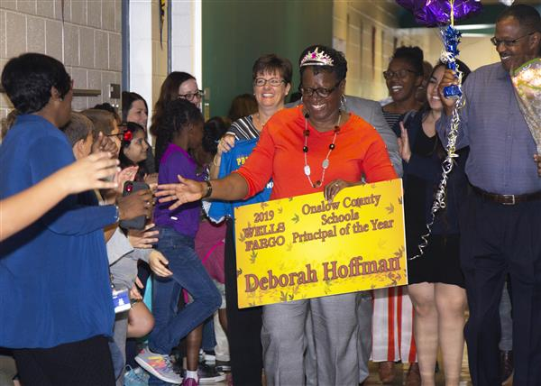 Deborah Hoffman is congratulated by staff and students