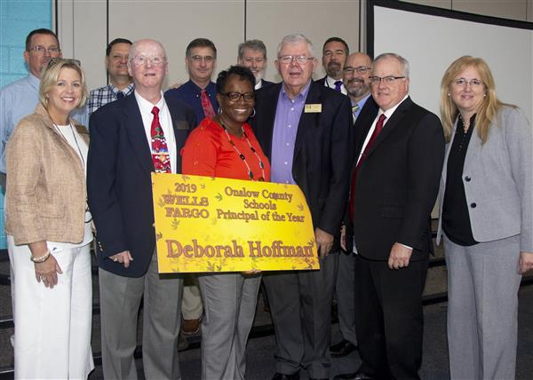 Deborah Hoffman poses with OCS Executive staff, Board members and district leadership