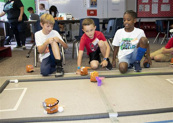 Campers put their robots through an obstacle