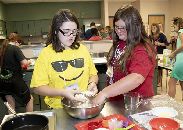 CogniCon campers work together to make pupusas