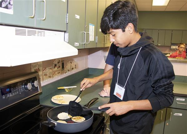 A CogniCon camper makes pupusas