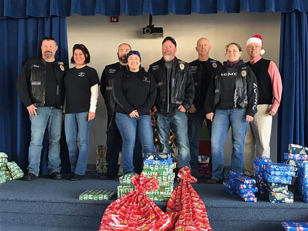 TECC Director James Lanier poses with the Americas Guardians Motorcycle Club