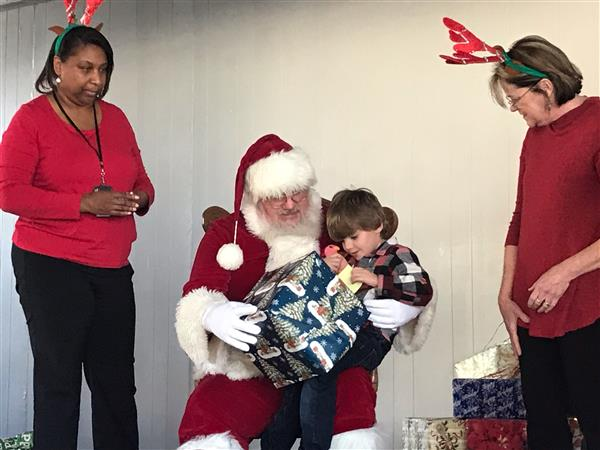 A TECC student receives a gift from Santa