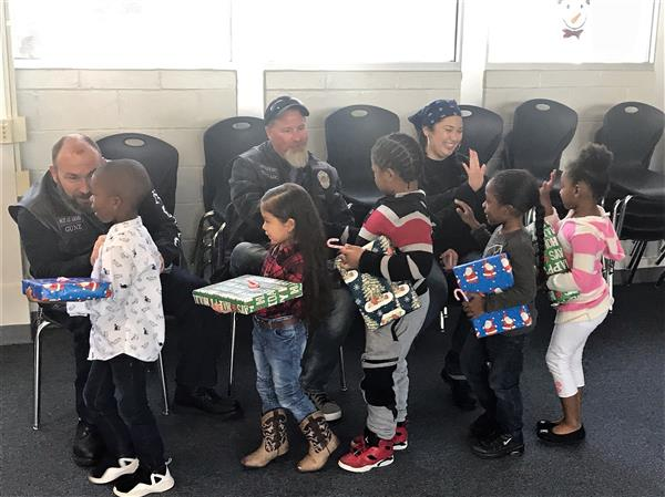 TECC students high-five and thank members of Americas Guardians Motorcycle Club