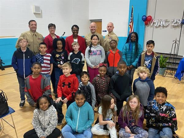 JCE students take a photo with their administrators and officers from MAG-29 and HMHT-302