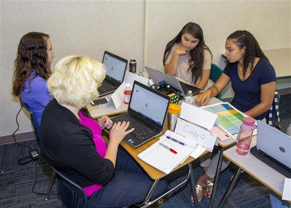 First year teachers and mentors work together at First Year Teacher Training