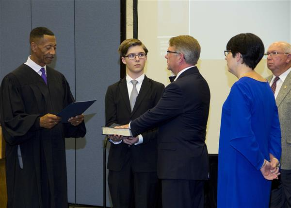 Jeff Hudson is administered the oath of office by Chief District Court Judge Paul Hardison