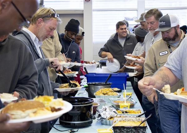 OCS Maintenance staff enjoy a buffet breakfast provided by the staff of TECC