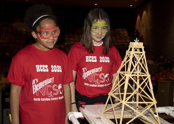 Students test their pasta tower at Science Olympiad