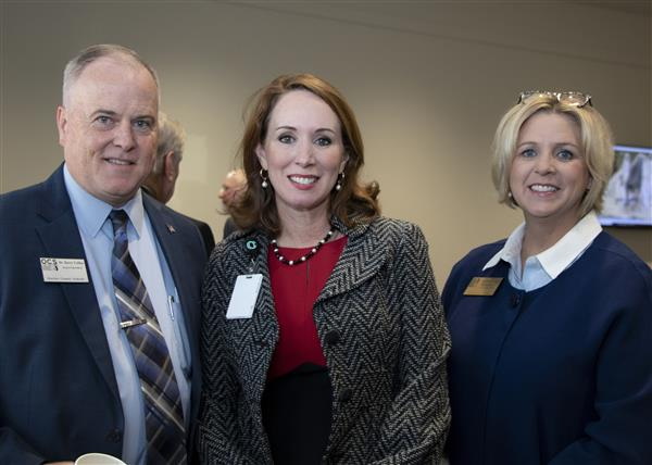 Dr. Barry Collins and Dr. Beth Folger take a photo with Interim County Manager Sharon Russell at the legislative breakfast