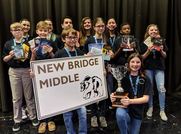 New Bridge Middle School students pose with their first place trophy