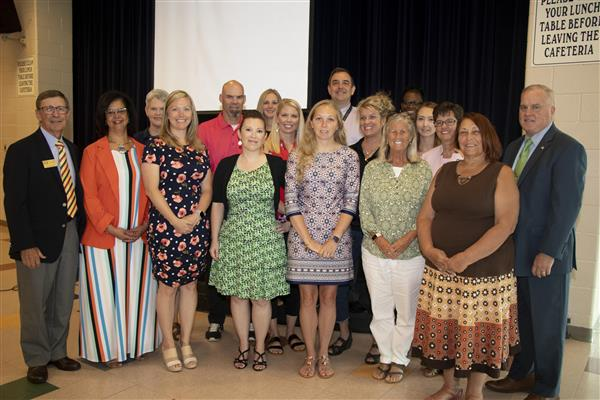The educators of the year take a photo with Dr. Collins and Board Member Ken Reddic
