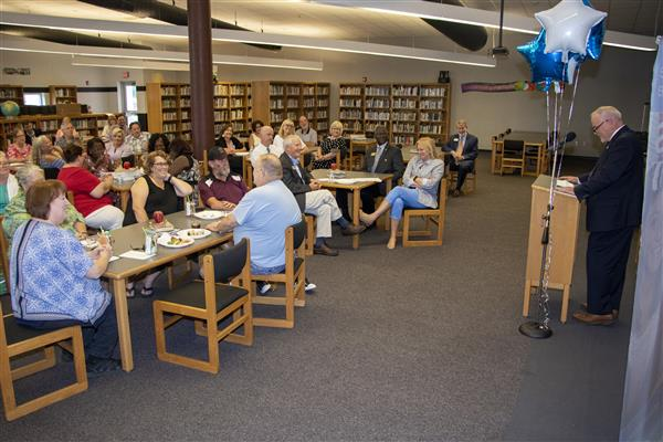 Dr. Collins speaks to retirees at the August 6 retirement reception