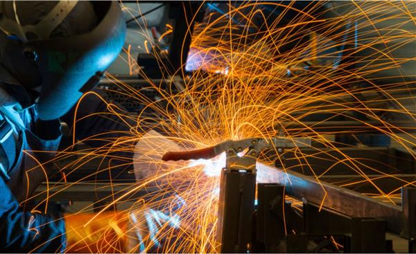 Sparks fly as student completes a weld