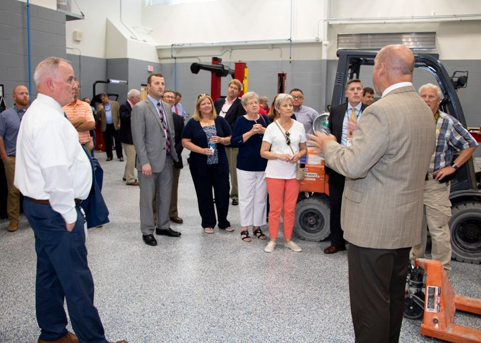 Board Members tour automotive bay