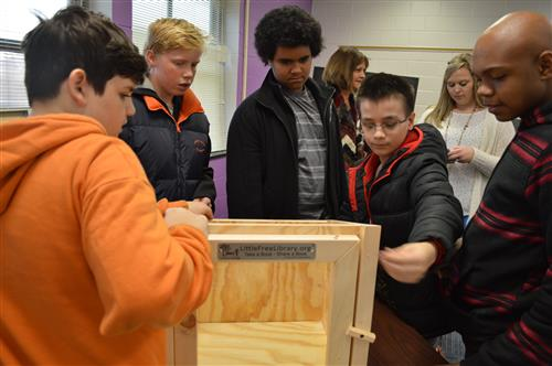 Students work to construct a Little Free Library