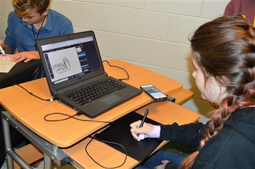 Using the Wacom Boards, students can hand draw images on the computer